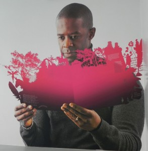 """In one of the stairwells at the Library of Birmingham is this image of Shakespearian actor Adrian Lester """"reading"""" a Shakespeare-inspired book"""