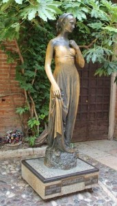 The statue of Juliet in the courtyard in Verona