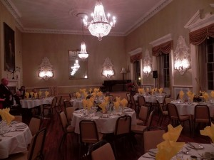 The upper room of the Town Hall set up for a dinner