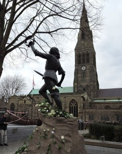 The statue of Richard III at Leicester Cathedral, with white roses