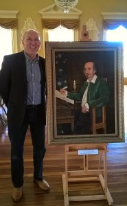 Geoff Tristram with his portrait of Shakespeare at Stratford's Town Hall