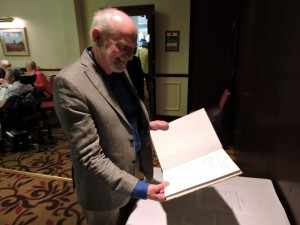 Stephen Sharp with his book