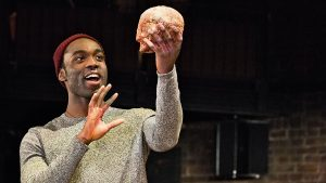 Paapa Essiedu (Hamlet) with Yorick's skull in HAMLET by Shakespeare opening at the Royal Shakespeare Theatre (RSC), Stratford-upon-Avon, England on 22/03/2016 design: Paul Wills lighting: Paul Anderson director: Simon Godwin ©Donald Cooper/Photostage donald@photostage.co.uk ref/0152
